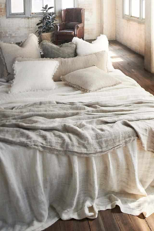 Natural Bedouin Oversized Linen Bed Throw layered with Bedouin Linen Cushions  on bed