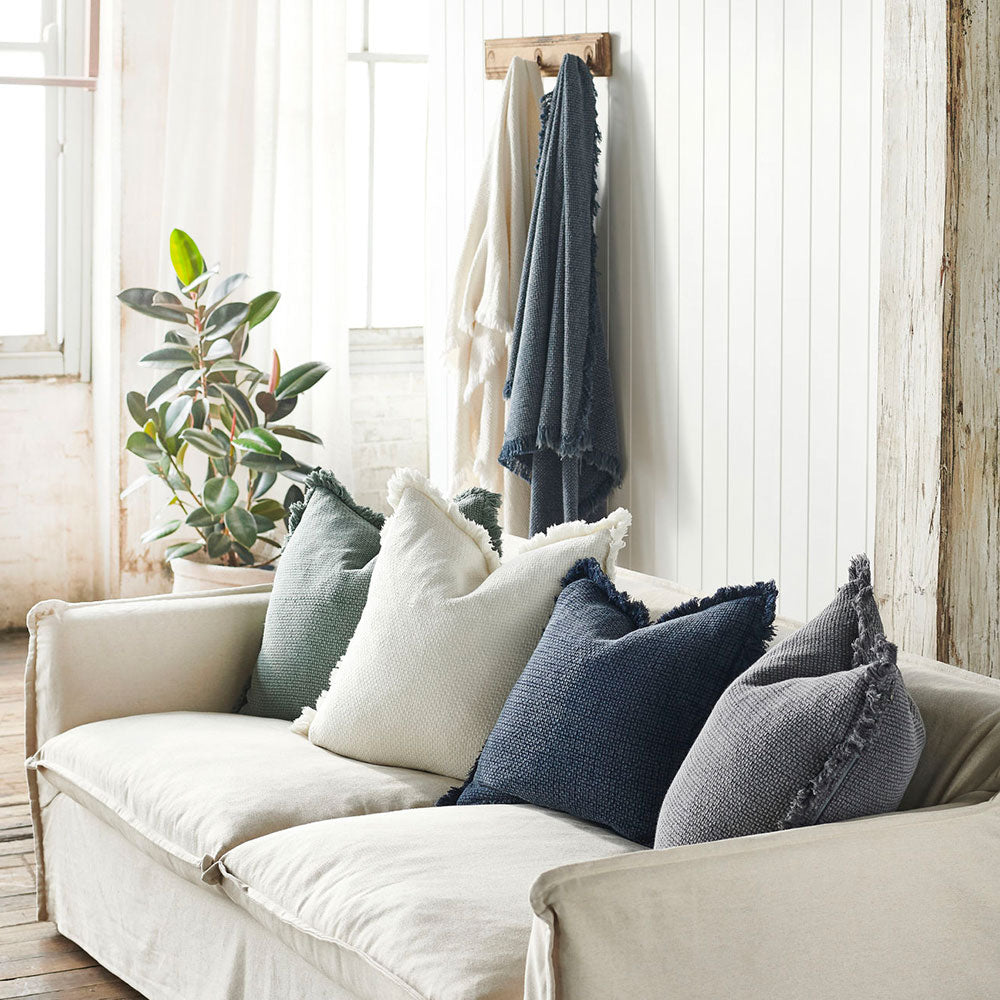 Chelsea cushions in white, khaki, navy and slate on a sofa