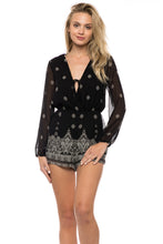 Sultry and Sheer Long-Sleeved Romper – Black and White
