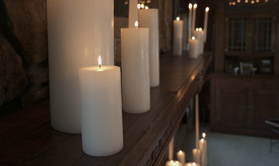 pillar candles on a mantle