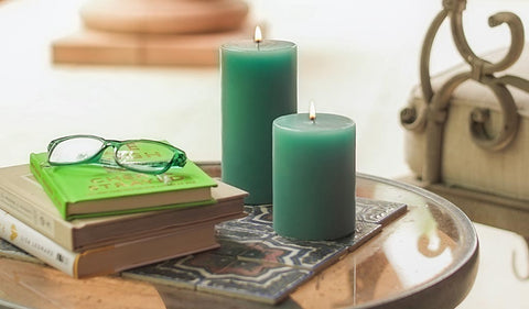 green candles books glasses