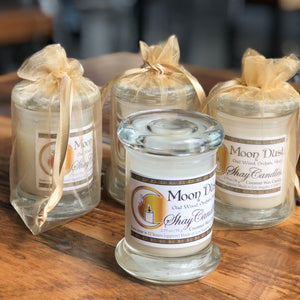 """Moon Dust"" is a powerfully scented candle that will take you on an intergalactic trip with its exotic Oud Wood, eerie Black Orchid and romantic Musk scents, in a sophisticated Elite Style Jar with a glass lid."