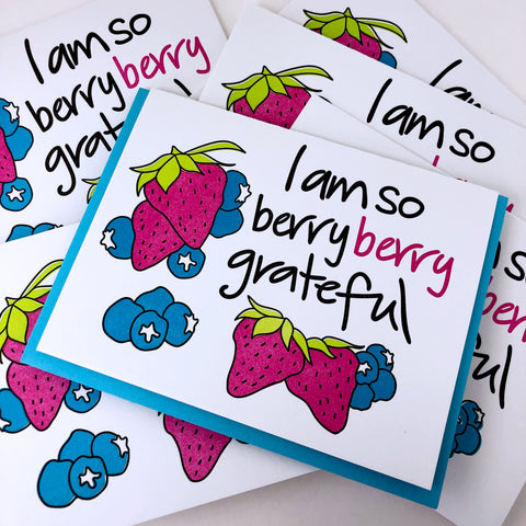 A stack of greeting cards that say I am so berry berry grateful