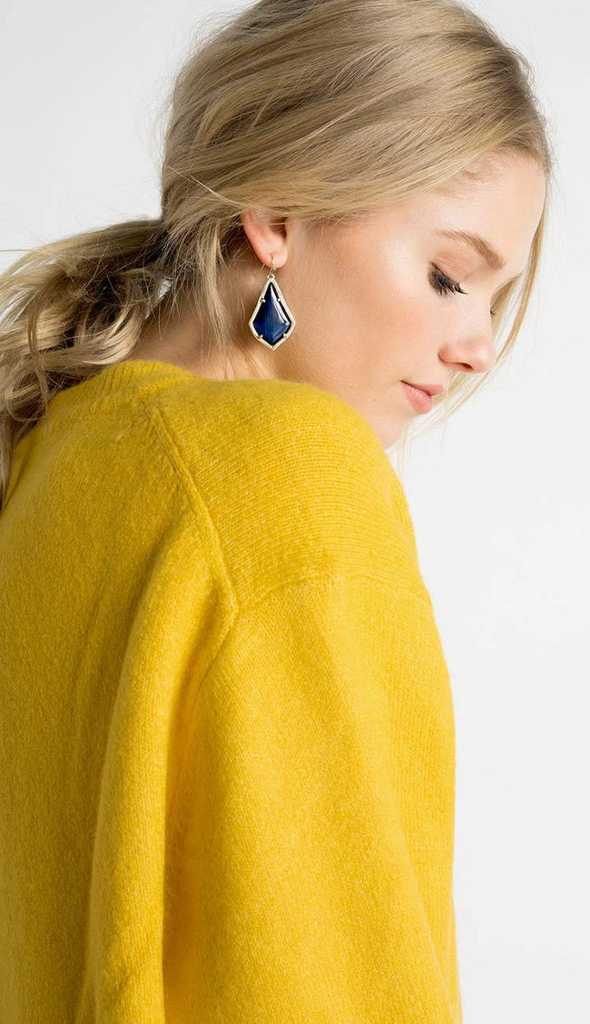 Alex earrings on model by Kendra Scott