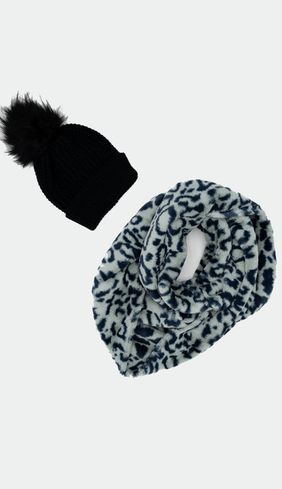 light blue leopard infinity faux fur scarf shown with navy knit faux fur pom pom hat - sold separately