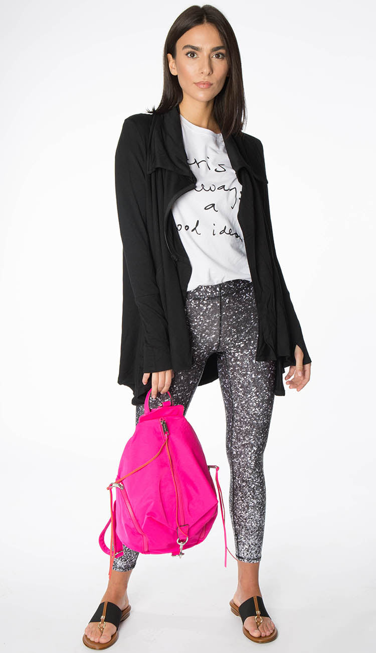 black drape jacket paired with glitter leggings, fuchsia backpack and Paris tee