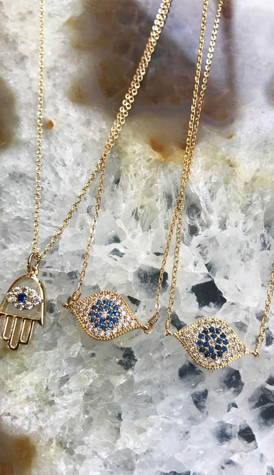 vanessa mooney christie hamsa necklace with the little evil eye necklace