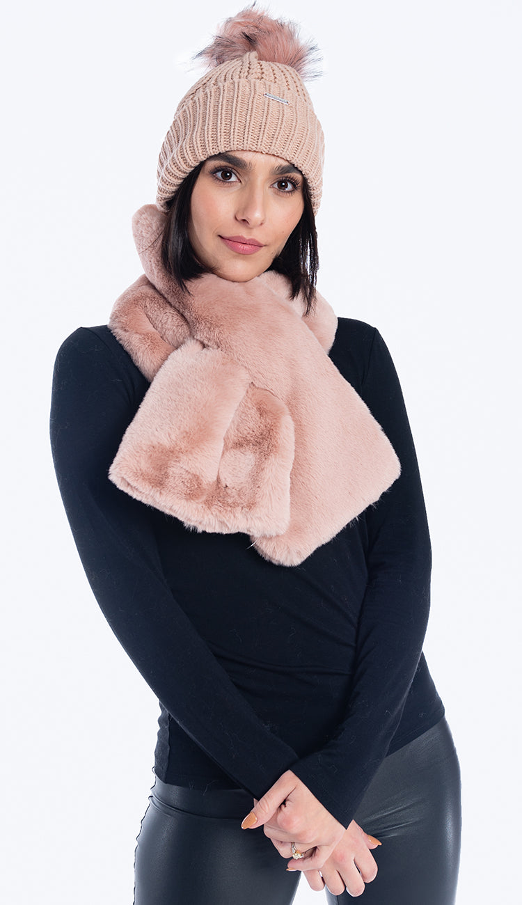 Knit hat with faux fur pom pom in misty rose. Shown with misty rose pull through faux fur scarf