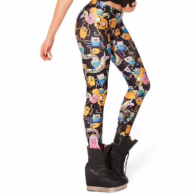 Side view of a women wearing Black Adventure Time leggings with pictures of Finn and Jake
