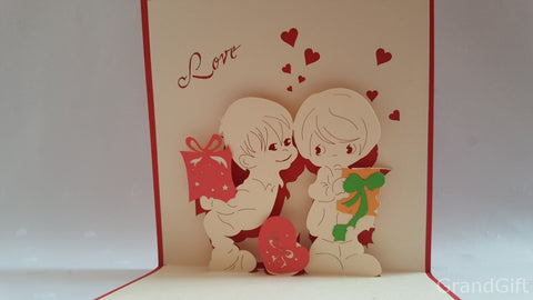 kids kiss among hearts with presents popup card