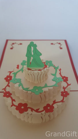 wedding cake with couple kissing on the top popup card