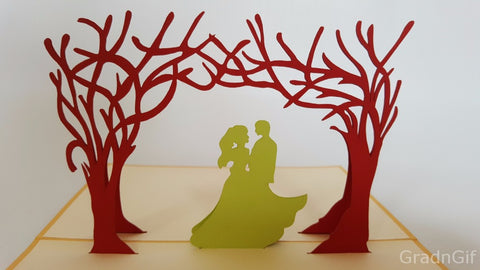 couple kissing under the red trees love popup card