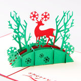 red reindeer standing inside the green forest 3d christmas popup card