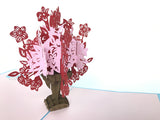 red pink ornate flowers inside vase popup card