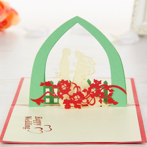 wedding couple under green arch love popup card