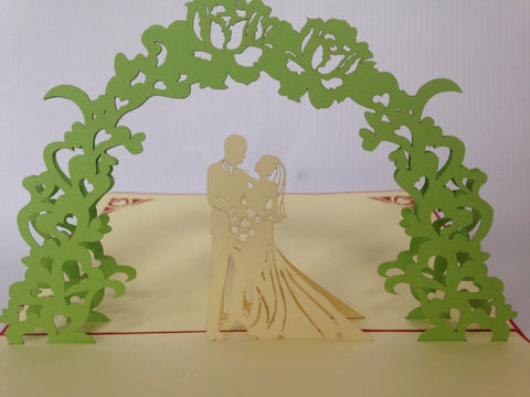 happy wedding couple under green floral arch 3d popup gift card