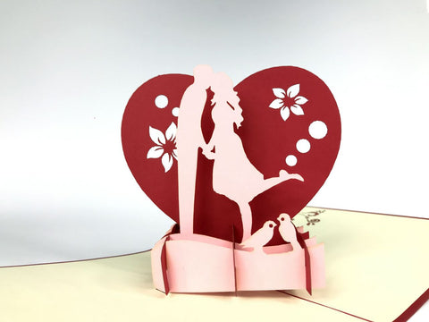 couple kissing on a heart background 3d pop up love card