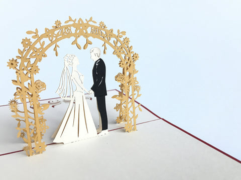 wedding couple standing under the golden arch 3d popup love card