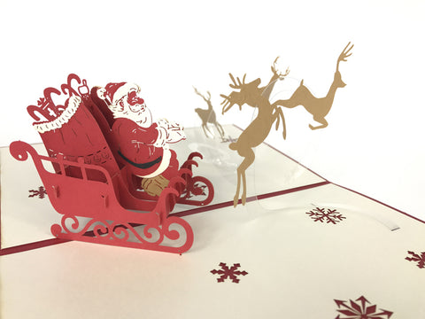 red santa claus inside sleigh with reindeer 3d christmas popup card