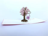 couple swinging on a cherry tree 3d pop up card