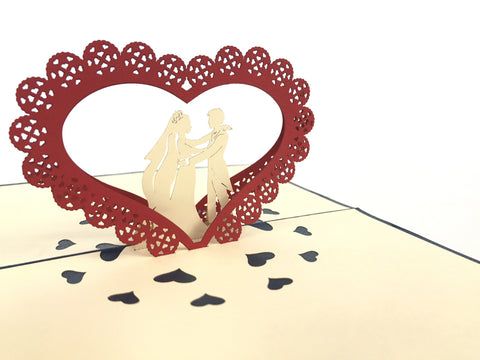 wedding couple standing under red heart arch 3d popup love card