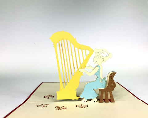 woman playing on a harp instrument 3d pop up card