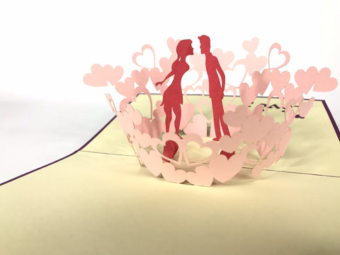 kissing love couple with a hearts around 3d pop up card