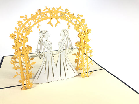 lesbian wedding couple under golden arch 3d pop up bride card