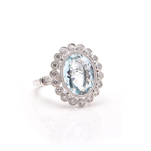 Aquamarine and Diamond Halo Dress Ring