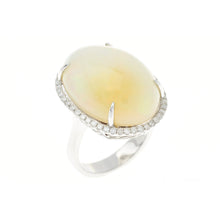 AN 18CT WHITE GOLD OPAL AND DIAMOND COCKTAIL RING
