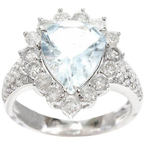 A PEAR CUT AQUAMARINE AND DIAMOND CLUSTER RING