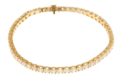 AN 18CT GOLD DIAMOND TENNIS BRACELET