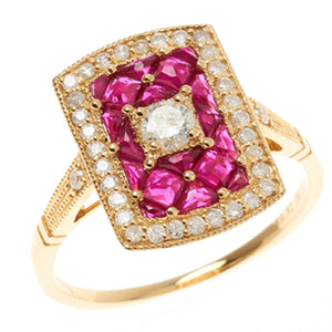 AN 18CT GOLD DIAMOND AND RUBY RING