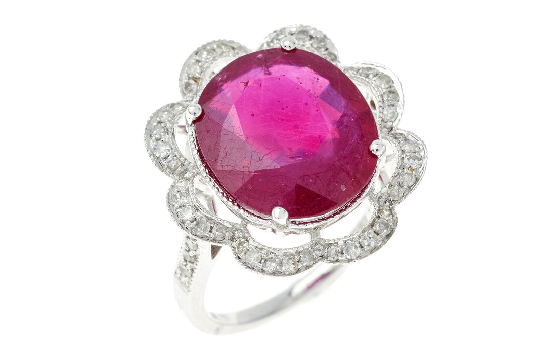A RUBY AND DIAMOND FLORAL CLUSTER DRESS RING