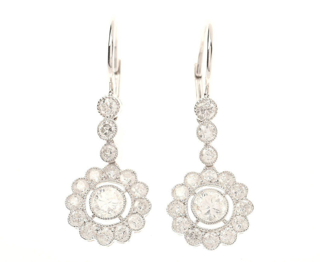 A PAIR OF DECO INSPIRED DIAMOND CLUSTER EARRINGS
