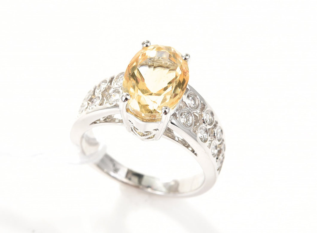 A CITRINE AND DIAMOND DRESS RING IN 18CT WHITE GOLD.