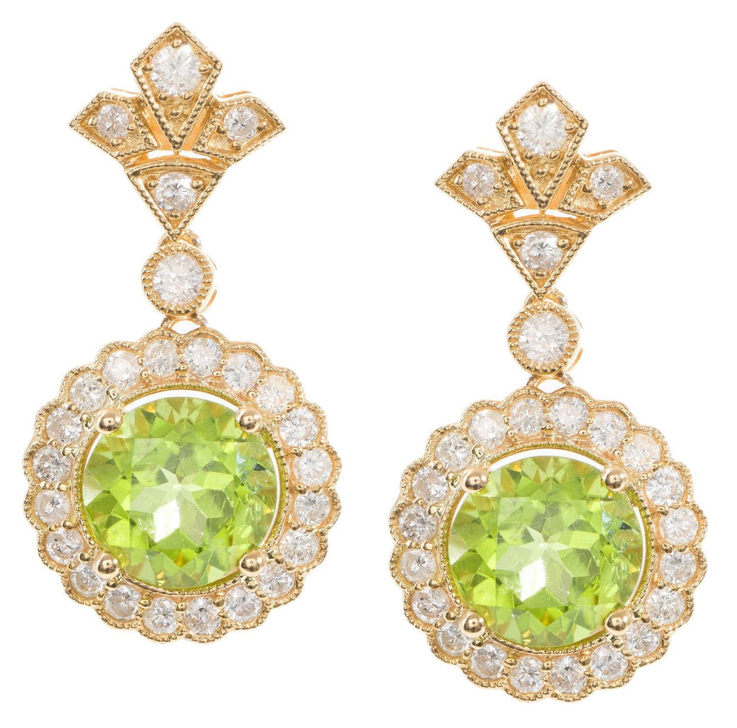 Each earring set with a round peridot of 2.55cts, in a surround and surmount of round brilliant cut diamonds totalling 0.54ct, in 18ct gold.