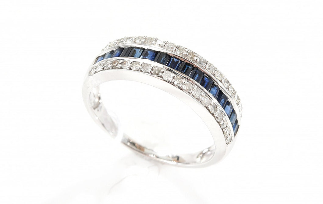 A SAPPHIRE AND DIAMOND CHANNEL SET DRESS RING IN 18CT WHITE GOLD