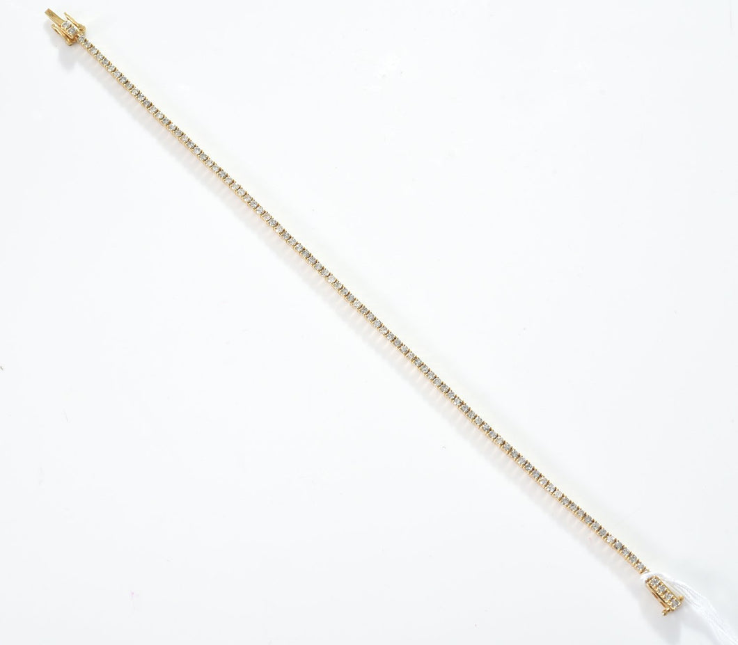 A DIAMOND LINE BRACELET IN 18CT GOLD