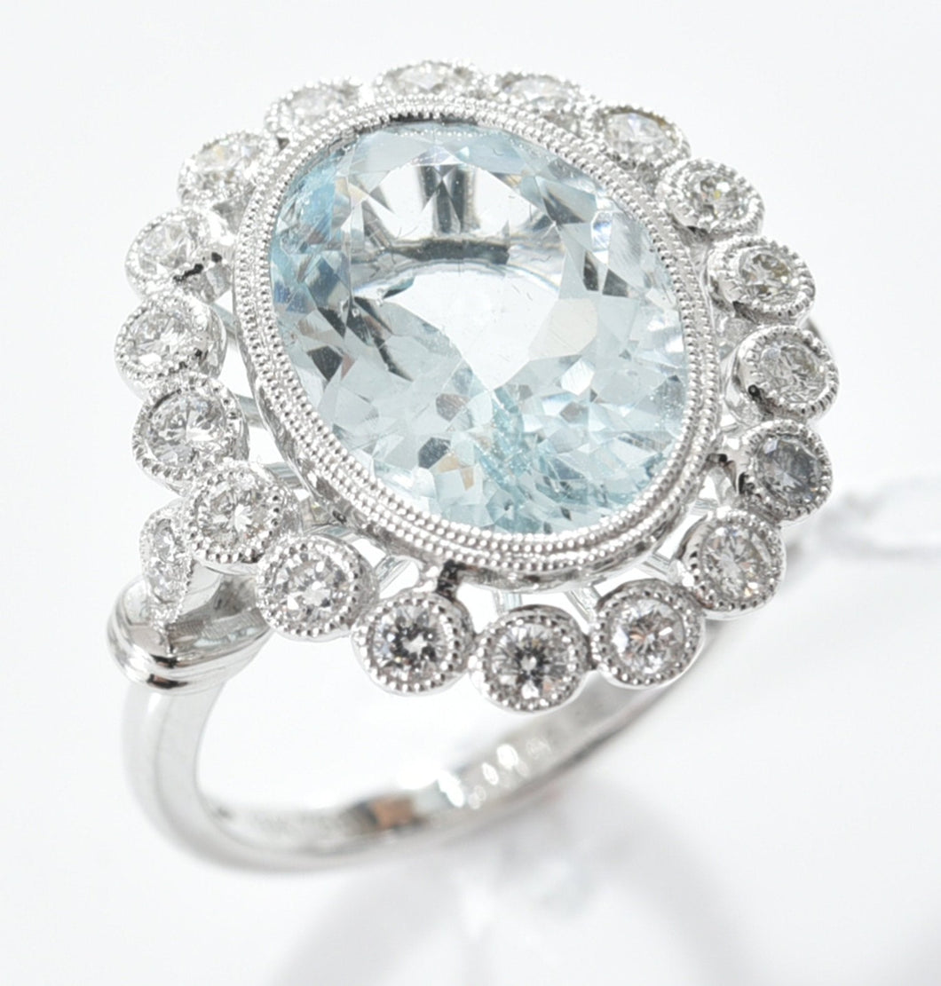 AN AQUAMARINE AND DIAMOND FLORAL CLUSTER RING