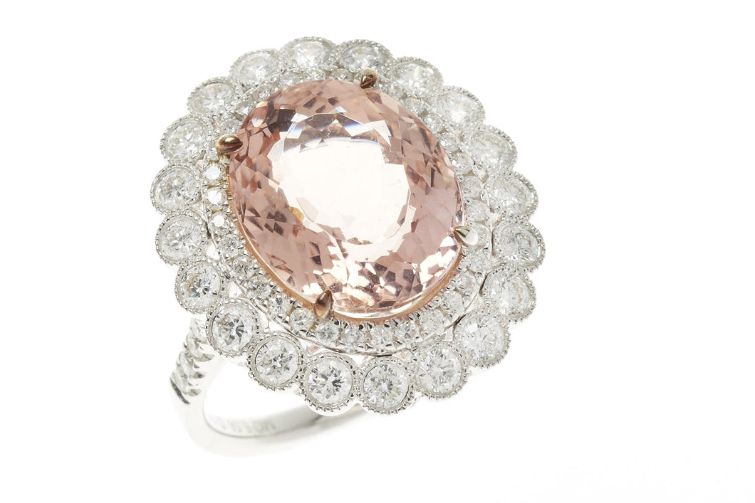 A SENSATIONAL 18CT WHITE GOLD MORGANITE AND DIAMOND CLUSTER RING