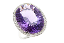 A LARGE AMETHYST AND DIAMOND COCKTAIL RING