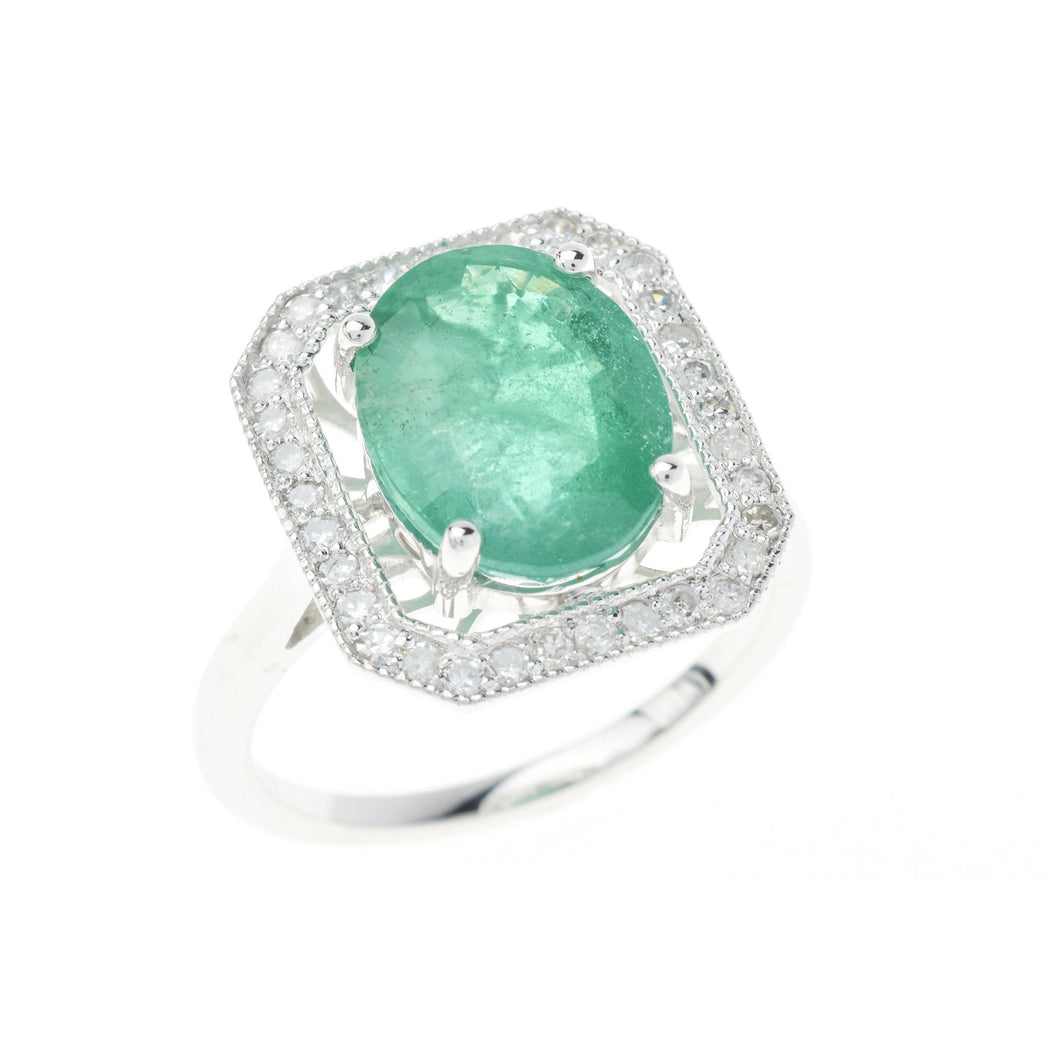 A PLATINUM EMERALD AND DIAMOND DRESS RING