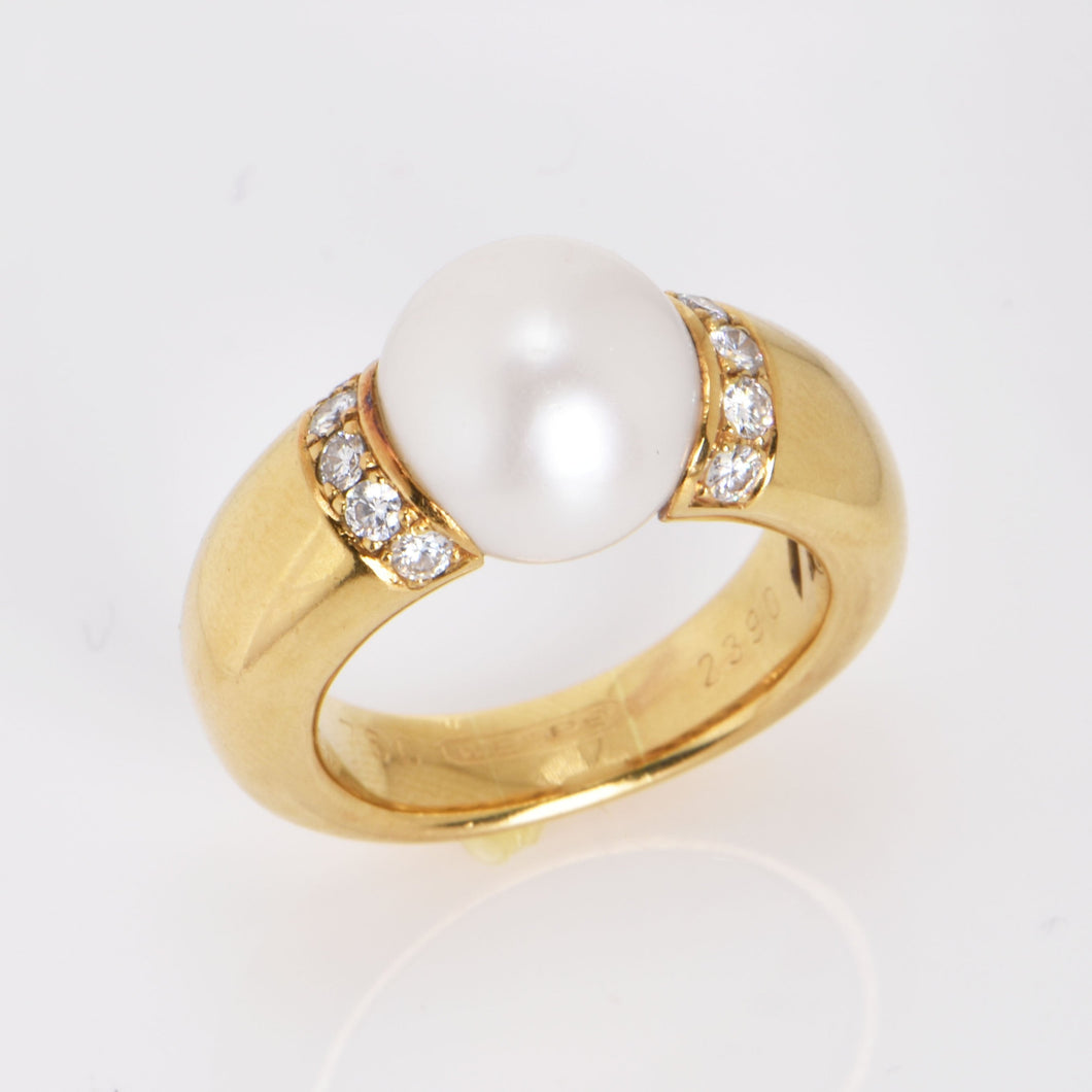 A South Sea pearl ring by Wempe, mounted in 18ct gold, pearl diameter 12.4mm, ring size P 1/2. Total weight 21.58gms.