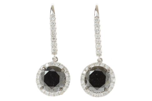 A PAIR OF BLACK AND WHITE DIAMOND CLUSTER EARRINGS