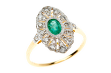 AN EDWARDIAN STYLE EMERALD AND DIAMOND RING