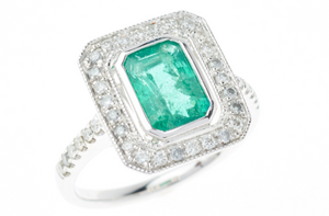 AN ART DECO INSPIRED EMERALD AND DIAMOND RING