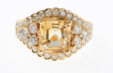 AN 18CT GOLD CITRINE AND DIAMOND RING