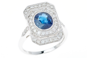 AN 18CT WHITE GOLD DECO STYLE SAPPHIRE AND DIAMOND RING