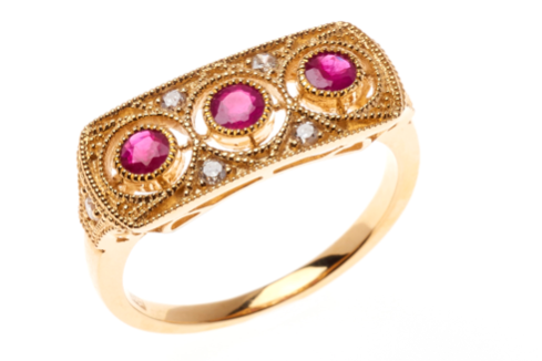 A DECO INSPIRED 18CT GOLD GEMSET RING